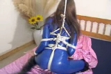 Angel in Blue Rubber Catsuit