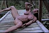 muscle lady poses on bridge 3