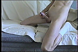 Twink plays with stiff cock